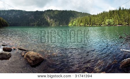 Wide panoramic photo of the Black Lake, the Largest natural lake in the Czech Republic is located in the Sumava mountains
