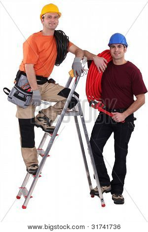 A team of tradesmen posing with their tools