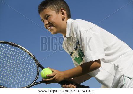 Young Tennis Player Preparing to Serve