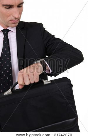 A businessman checking the time.