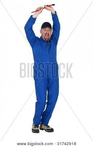 Excited worker holding wrench