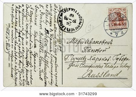 GERMANY - CIRCA 1909: reverse side of a postcard printed in Germany shows letter and postage stamp of German Reich Postcard printed in thr USSR shows paint by, circa 1909