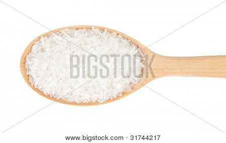 Sodium glutamate in a wooden spoon. isolated on a white background