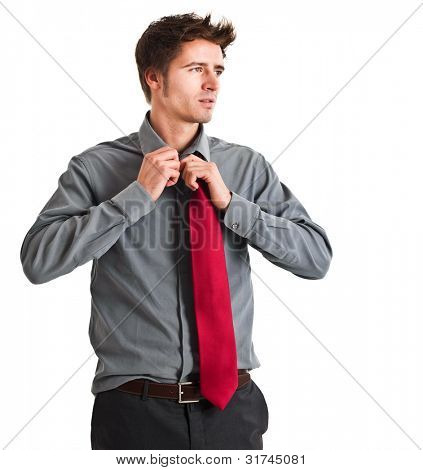 Businessman loosening his collar