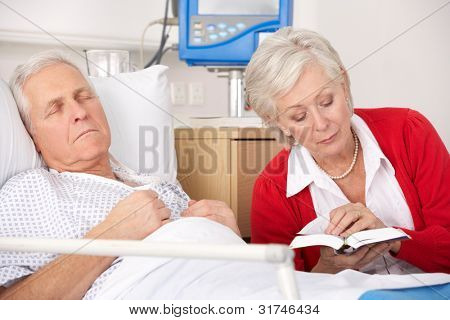 Senior woman visiting husband in hospital