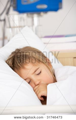 Young girl asleep in Accident and Emergency bed