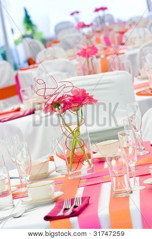 Fun wedding tables set for dining during a banquet or wedding event