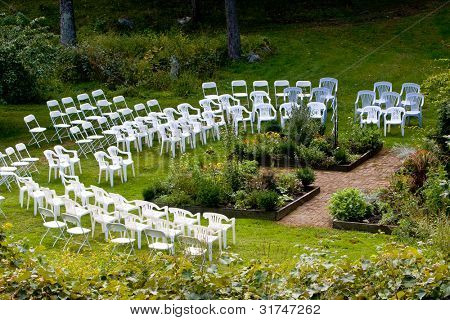 An area set up with chairs for an outdoor wedding ceremony
