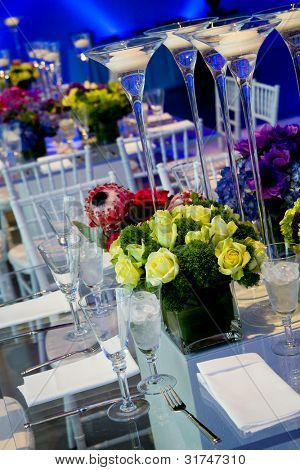 wonderful wedding decorations, with clear glass tables, flowers, and candles