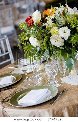 details from a wedding. Table set for fine dining with a flower bouquet
