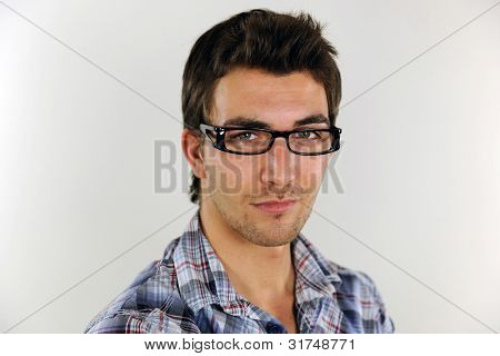 portrait of a young casual man on white background