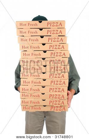 A Deliveryman hidden behind a large stack of pizza boxes he is carrying. Vertical format over white.