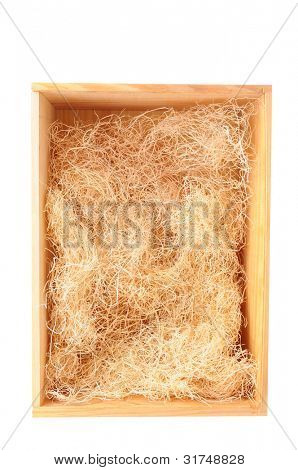 An overhead view of an empty wood shipping crate with straw packing material, Vertical format over a white background.