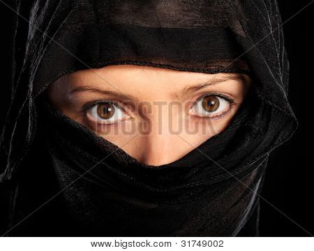 A picture of a young muslim woman over black background