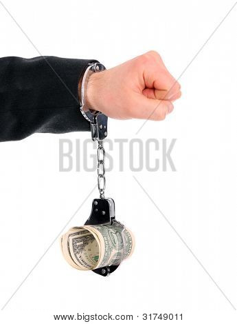 A picture of a male hand chained to money over white background