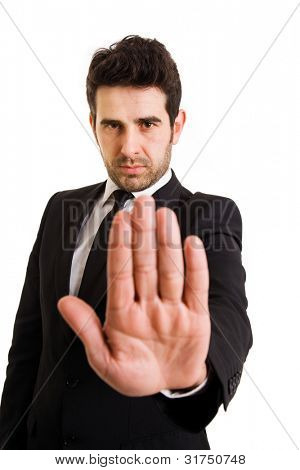Businessman making stop sign on white background