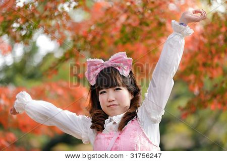 japanese lolita portrait in park during fall season, Tokyo