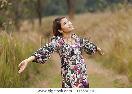 happy young woman breathing in wild nature, thailand
