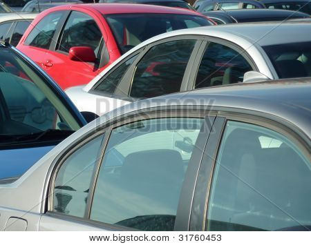 Telephoto view of cars parked in parking lot. Image can be reversed for non British uses. Also useful for environmental issues.