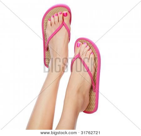Funny pink sandals on female feet. Isolated on white background.