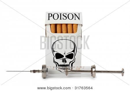 Color photograph of old medical syringes and cigarette