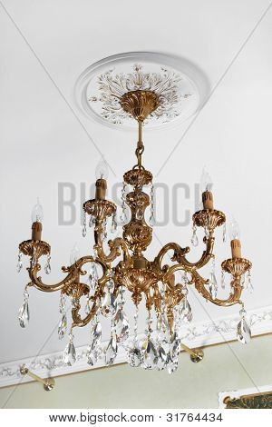 beautiful bronze chandelier in a modern apartment