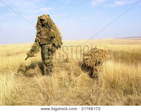 Camouflaged Soldier Aiming. Snipers. Army