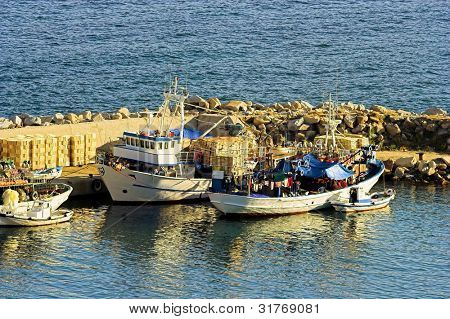 some fishing boats in a dock