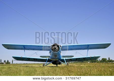 biplane before take-off isolated on blue sky