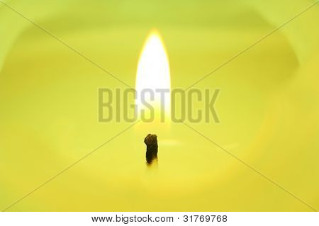 Closeup of lighting candle suited for relaxing ads usage