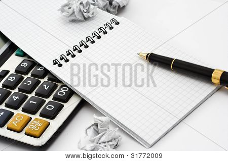 blank notebook whit pen and calculator, close-up