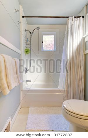 Small Blue Bathroom With Light Grey Blue.