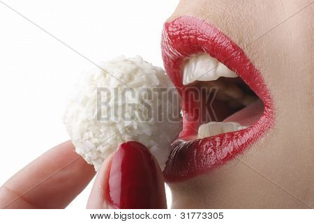 Beautiful girl eating white candy, close-up