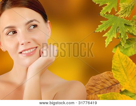 Close-up of a woman face in autumn frame