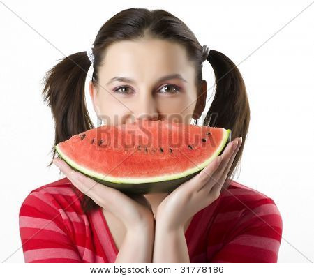 Pretty smiling woman with water-melon