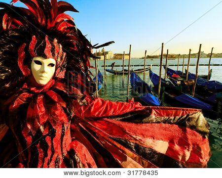 Traditionally dressed Venice carnival person in Piazza San Marco, Italy