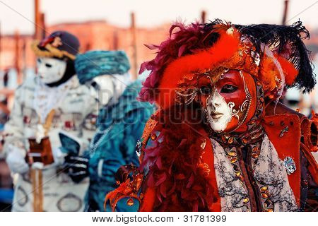 Traditionally dressed Venice carnival persons in Piazza San Marco, Italy