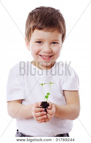Boy with sprouts in hands