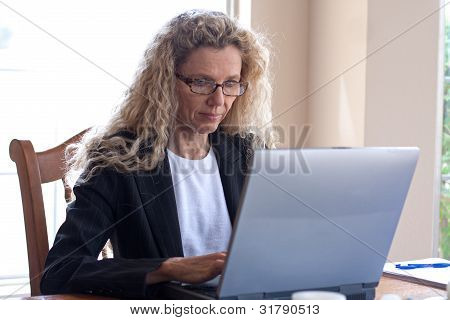 Woman On Table With Laptop