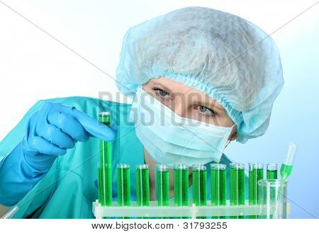 Young female scientist working in chemistry laboratory