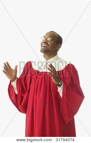 Man in choir robe singing