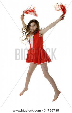 A pretty elementary cheerleader jumping with her red and white  pompoms.  Motion blur on hands and pompoms.  On a white background.