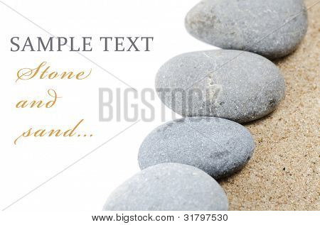 The stones on sand isolated on white