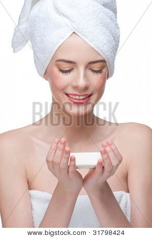Portrait of young beautiful woman in white towel holding soap on her palms. Isolated on white background