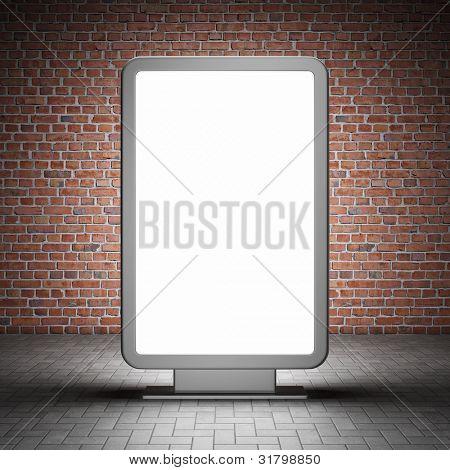 Blank street advertising billboard and brick wall at night