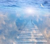 stock photo of gates heaven  - Figure on path  in serene space - JPG
