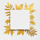 Flat Lay Creative Autumn Composition. Paper Blank And Golden Leaves On White Gray Background Top Vie poster