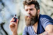 Man With Beard Breathe Out Smoke. Clouds Of Flavored Smoke. Bearded Man Smoking Vape. Smoking Electr poster