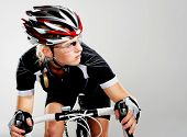 stock photo of bicycle gear  - Road bicycle woman riding her bike and concentrating on winning the cycle race - JPG