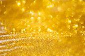Golden Glitter Lights Background.christmas Background. Golden Holiday Abstract Glitter Background .d poster